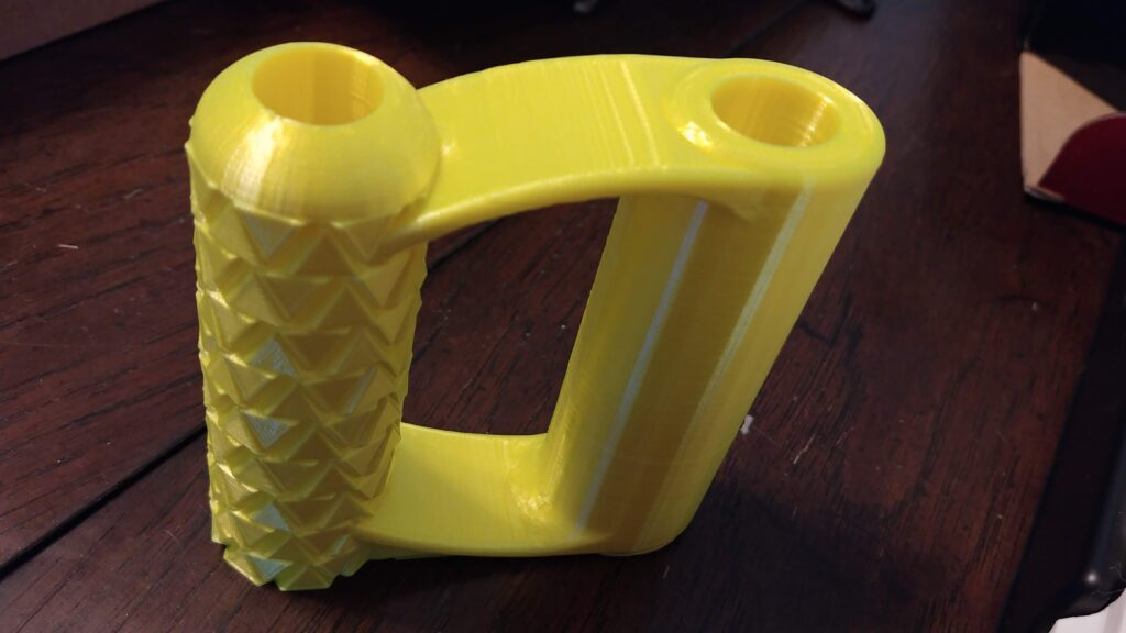 fluorescent yellow PLA shovel handle in different light