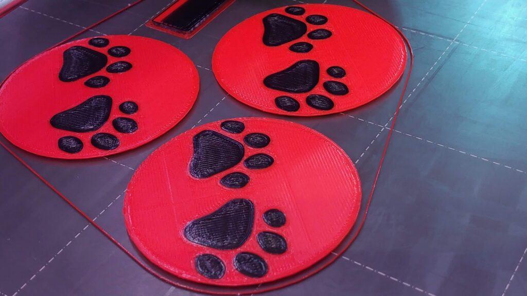 Orange PLA+ and Black Dog Paws Apple Emoji