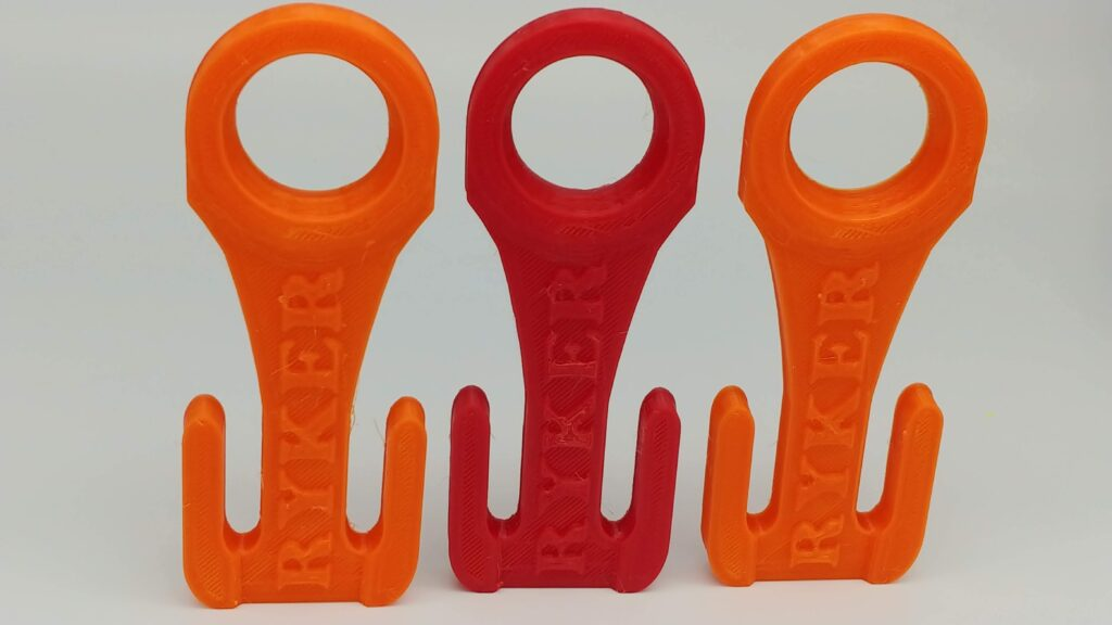 Solid Orange PETG on ends with solid Red PETG in middle