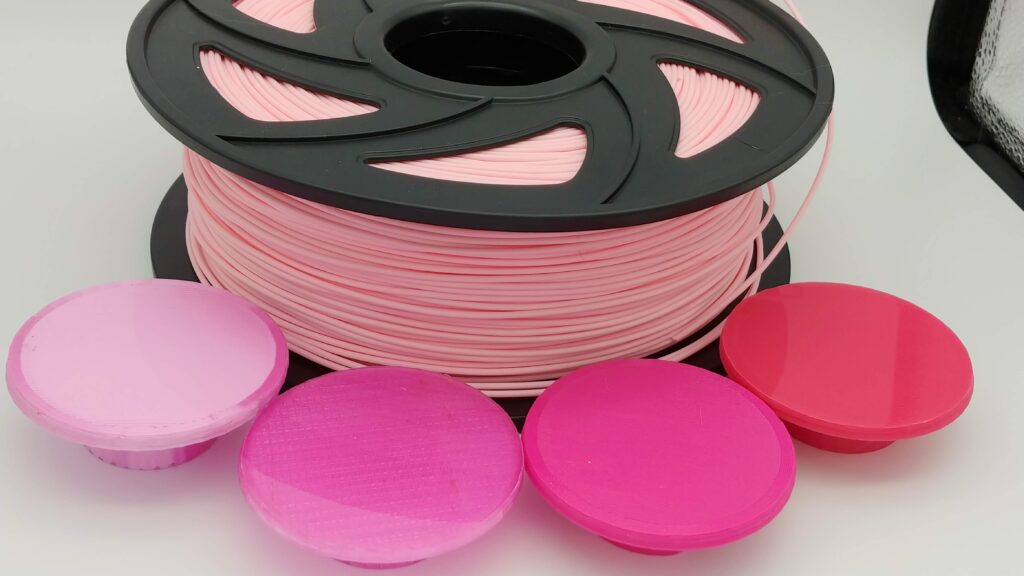 Roll is Powder Pink PLA, far left is silky light pink PLA, next is translucent Pink PETG, then Magenta and last on far right is dark Pink PLA+